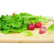Radish and lettuce on wooden board, isolated — Stock Photo