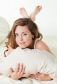 Pretty young woman in bed — Stock Photo