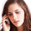 Pretty brunette girl on the phone — Stock Photo #8482195
