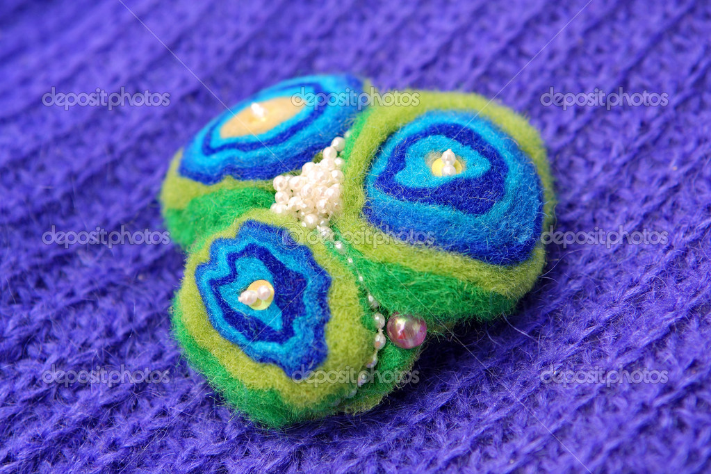 Felt of natural wool brooch — Stock Photo #9164578