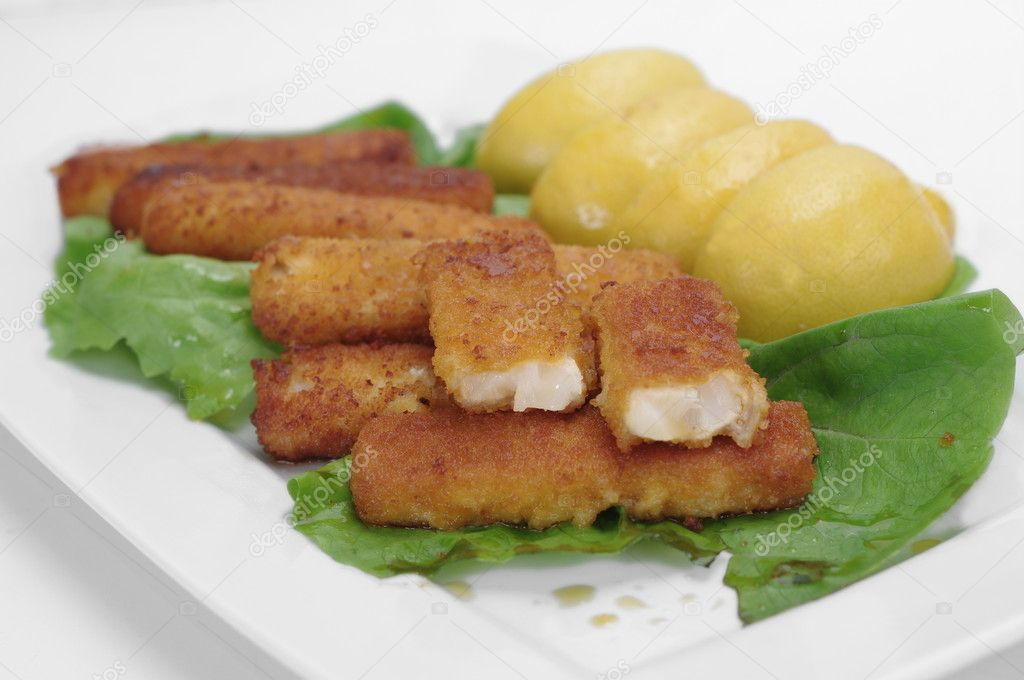 Appetizing fish  fingers on white plate — Stock Photo #8930195