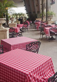 Patio Tables with Red Checkboard Tablecloths — Stock Photo