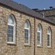 Stock Photo: Old Arched Windows in Stone Building