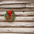 Christmas Wreath on an Old Wooden Wall BW — Stock Photo #9409442