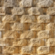 Textured Interlocking Block Wall in Morning Light - Stock Photo