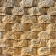 Textured Interlocking Block Wall in Morning Light — Stock Photo #9476884