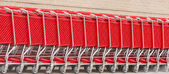 Row of Red Shopping Carts — Stock Photo