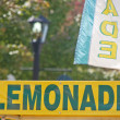Signs Over Lemonade Stand — Stock Photo #9510436