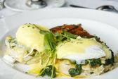 Eggs Florentine Benedict on White Plate — Stock Photo