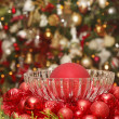 Stock Photo: Red Christmas Ornaments with Tree in Background