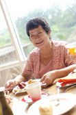 Senior woman enjoying her dining — Stock Photo