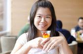 Asian woman enjoying her dessert — Stock Photo