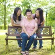 Asian mother and daughters — Stock Photo