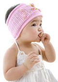Cute baby girl eating — Stock Photo