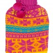 Stock Photo: Rubber hot water bottle in knitted cover color