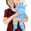 Grandmother with her grandson in her arms in the studio — Stock Photo