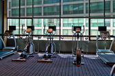 Gym a stationary bike — Stockfoto