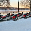Vehicles are a number of snowmobiles — Stock Photo #8881359