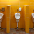 Three urinal in the bathroom — Stok fotoğraf