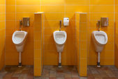 Three urinal in the bathroom — Stock Photo