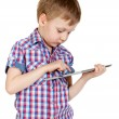 A boy in a plaid shirt with a tablet computer — Stock Photo