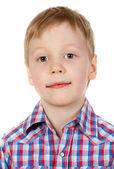 Portrait of a boy in a plaid shirt — Stock Photo