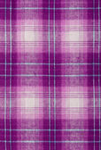 Purple cloth, checkered background — Stock Photo