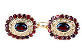 Gold earrings with ruby  — Stock Photo