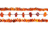 Beads of amber laid in a row — Stock Photo