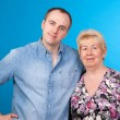Portrait of mother and son in a studio — Stock Photo