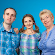 Happy family in the two-party — Stock Photo