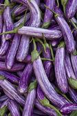 Eggplants on vegetable market — Stock Photo