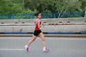 BELGRADE, SERBIA - APRIL 22: An unidentified woman runs in 25th Belgrade Maratho — Stock Photo