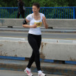 BELGRADE, SERBIA - APRIL 22: An unidentified woman runs in 25th Belgrade Maratho — Zdjęcie stockowe