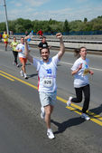 BELGRADE, SERBIA - APRIL 22: A group of marathon competitors during the 25th Belgrade Marathon on April 22, 2012 — Photo