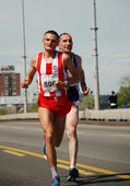 BELGRADE, SERBIA - APRIL 22: Marathon competitors during the 25th Belgrade Marathon on April 22, 2012 — Stock Photo