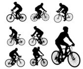 Bicyclists silhouettes — Stok Vektör