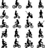 Bambini in sella a biciclette — Vettoriale Stock
