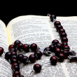 Christian Holy Bible with Crucifix on rosary — Stockfoto
