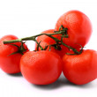 Bunch of delicious fresh tomatoes isolated on white background - Stock Photo