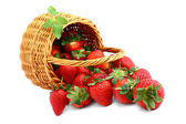Delicious strawberries in basket isolated on white — Stock Photo