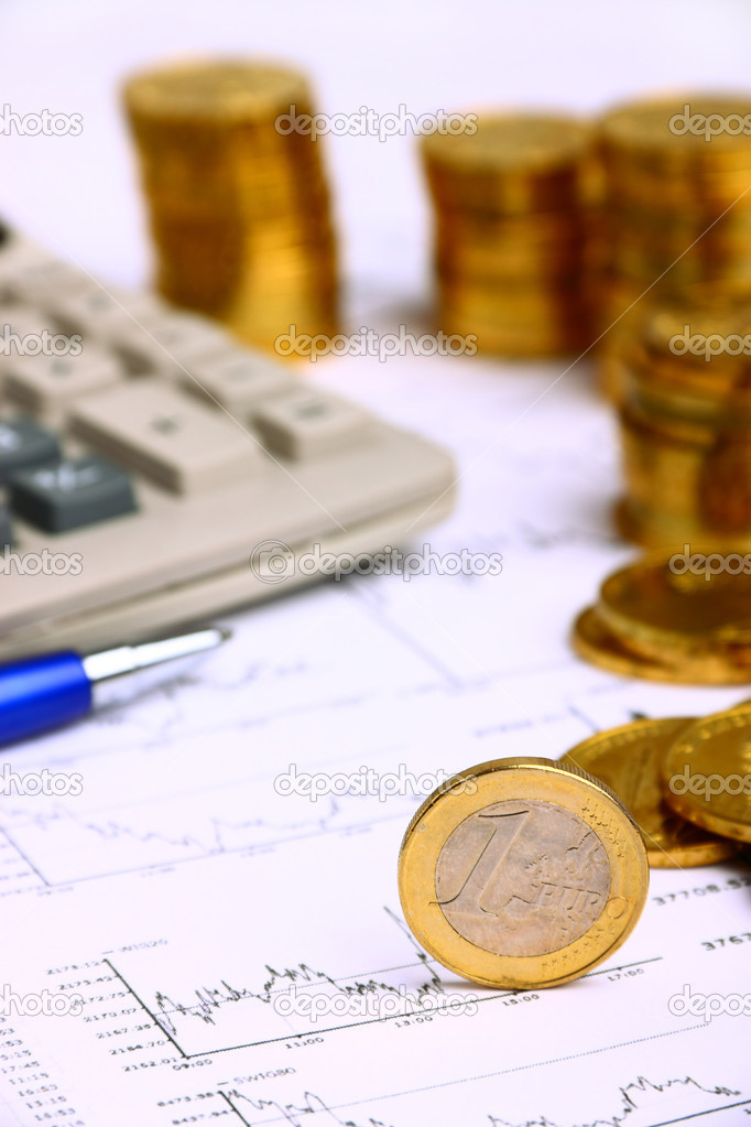 Money coins, calculator on the businness stock charts — Stock Photo #8935844