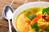 Fresh vegetable soup made of carrot, potato, leek, pea — Stock Photo