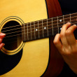 Playing classic spanish guitar — Stock Photo