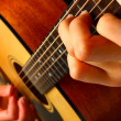 Playing classic spanish guitar — Stock Photo #9772183