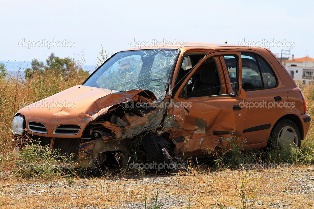 Crushed small car in bad traffic accident — Stock Photo #10101460