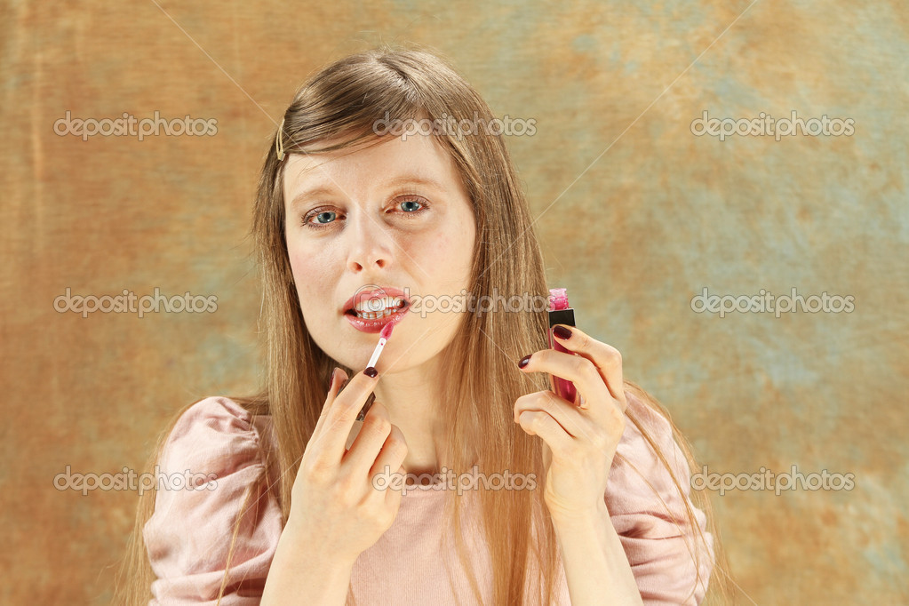 Young blonde girl putting lipstick make up — Stock Photo #10263056
