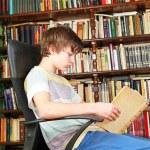 Boy reading book — Stock Photo #10636167