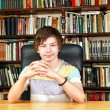 Boy in library — Stock Photo #10636168