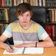 Boy writing — Stock Photo